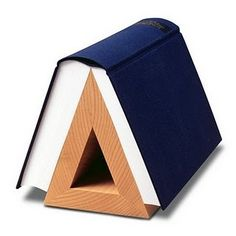 "Ha! A ""book hook."" I wouldn't call it ""art on the nightstand,"" but it's pretty clever."