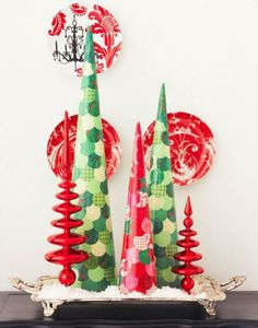Use foam cones, holiday papers and decoupage glue to create the three trees here. More easy Christmas crafts: http://www.midwestliving.com/holidays/christmas/easy-christmas-crafts/