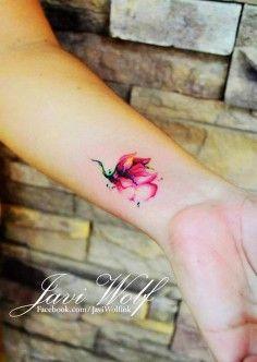 flower watercolor tattoo on girls wrist