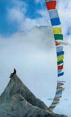 Tibetan Prayer Flags. It is believed that the prayers on the flags are lifted and spread throughout the universe as they flutter in the wind. Everyone who is touched by that wind, is touched by the prayers. The wind spreads the prayers through the world, extending happiness, good will, and peace.