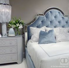 Deco sky blue headboard with silver trim linen wrapped dresser Bernhardt bedroom | The Decorating Diva, LLC