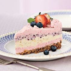 Strawberry Smoothie Ice Cream Pie | Fresh strawberries team up with blueberries and bananas for a triple-layered ice cream treat. The big surprise? Crushed waffle cones are the secret ingredient in this fun crust. For super-sharp slices, remove the frozen pie from the spring-form pan, and place on a cutting board. Using a large chef's knife, cut the pie in half; cut each half into the desired number of slices, and serve immediately. | SouthernLiving.com
