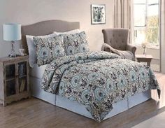 Paisley Bedding This bedding set features large paisley  patterns in tan, blue and green colors  that reverse to a larger scale scroll  pattern.