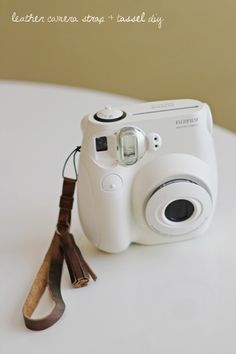 metallic leather camera strap + tassel diy