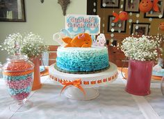 Adorable girlie goldfish cake - fondant topper by Sugar and Stripes Co.