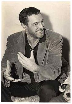gene kelly looking ruggedly handsome.
