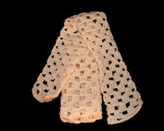 This beautiful handmade crocheted scarf comes in a soft cream color that will go with any outfit. So cute!