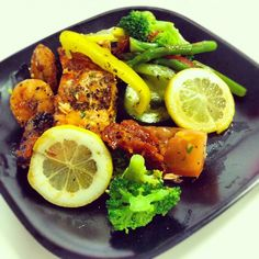 Spicy shrimp and baked lemon salmon complimented by fresh, crunchy veggies. Follow my Instagram for more low calorie meal ideas! @robolikes