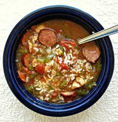 SLOW COOKER JAMBALAYA    1 lb skinless, boneless chicken breast, cut up into small pieces  1 lb andouille sausage, sliced  1 28oz can diced tomatoes with juice  1 large onion, chopped  1 large green bell pepper, chopped  1 c chopped celery  1 c chicken broth  2 tsp dried oregano  2 tsp dried parsley  2 tsp Cajun seasoning  1 tsp cayenne pepper  1/2 tsp dried thyme  1 c instant rice    1. Place all ingredients except rice in slow cooker. Cook on low for 7-8 hours, or on high for 3-4 hours.    ...
