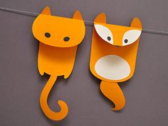 Simple Paper Cat and Fox Garland. I think a bunch of multicolored cats would be very sweet for a birthday party decoration!