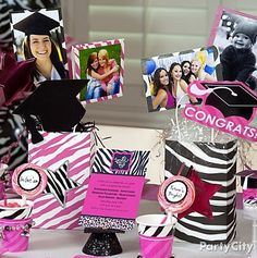 Easy DIY graduation party centerpiece made with photos of the grad and zebra gift bags.