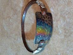 Copper hammered annealed bangle with brass metal etch plate and sterling wire wire wrap .