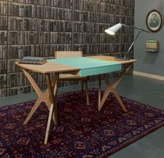 The Portuguese company Matrioskas is back with a new collection of oak furniture that has a bit of a vintage/mid-century feel. The pieces are wood based, as most of their work is, with pops of bright colors that make them even more unique. While each piece has some sort of color or embellishment, at the core is good design with simple, yet interesting shapes.