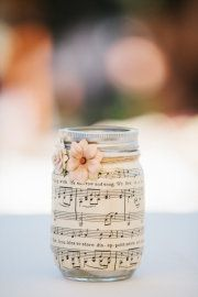 Modgepodge book pages or sheet music on jar.