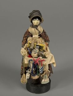 Peddler Doll  doll  1850-1880  Material	carved | wood | painted  Origin	England?  Style	pedlar  Object ID	79.10907  National Museum of Play Online Collections