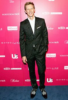 Gabriel Mann greeted fans and reporters in a snazzy pinstripe suit and Mezlan shoes.