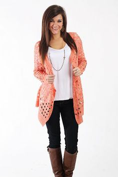 "The Breakfast Cardigan, Coral $41.00 This item is a great addition to your cardigan collection! The color is beautiful and this cardigan has plenty of style, with the cutouts throughout and the draped front. This is a great layering piece when it's cold or lightweight cover in the warm months!   Fits true to size. Miranda is wearing a small.   From shoulder to hem:  Small - 27.5""  Medium - 28""  Large - 28.5"""