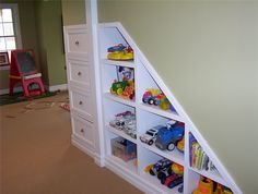 under stairs basement playroom | ... the awkward space from under these stairs to be used efficiently Basements Playrooms, Basements Storage, Toys Organizations, Storage Under Stairs, Stairs Storage, Basements Stairs, Finish Basements, Storage Design, Storage Ideas