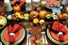 Fall tablescape...chicken feeder filled with pumpkins and gourds...