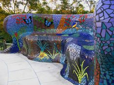 Outdoor poolside seat constructed of hebel with ceramic mosaic covering