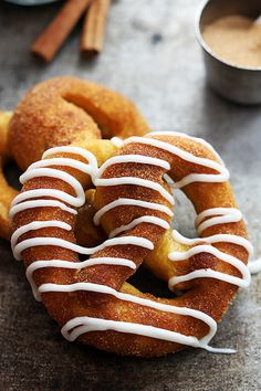 Soft pumpkin pretzels coated in cinnamon sugar and drizzled or dipped in vanilla icing! Just 30 minute prep and they're made from scratch!