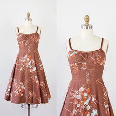 Brown and Orange Floral Smock Back Dress by Deweese Design.