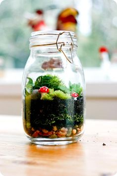 """terrariums for the tables. made with polymer clay and sculpey, and then placed in little mason jars with moss and dirt and stones. pretty easy centerpiece for tables! i would also add a little stick with a cute white marker on it to say, """"Table Five"""", etc."""