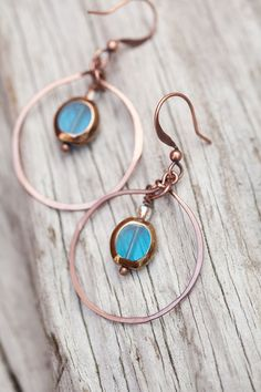 Oh these are gorgeous!! Deep turquoise glass copper hoop Earrings by beesandbuttercups, $22.00