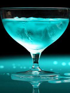 Aqua Blue Cruise 2 oz. vodka ¼ oz. lemon juice ½ oz. Hpnotiq liqueur 1 oz. white cranberry juice  Combine all ingredients in a shaker filled with ice, shake, and pour into a glass.