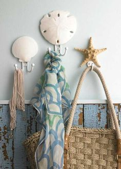 Hang a shell above the hook...great idea for the beachy bathroom