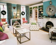 Living Room Photo - A white couch and a pair of patterned armchairs in a blue living space