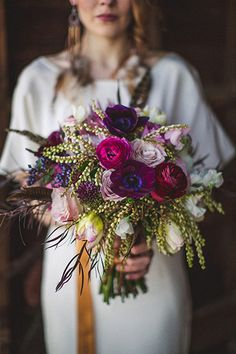 lush purple bouquet // photo by The Willinghams http://ruffledblog.com/feathers-and-wood-wedding-inspiration/