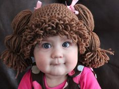 Cabbage Patch Kids wigs!!! I truly thought the baby was a doll:)