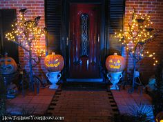 Pumpkins in planters. PVC trees with lights at sides.