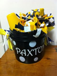 This is a personalized bucket I made for my cheerleading squad to keep up with their pom poms and megaphone.