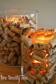 Wine cork candle holder!!  this & super easy - candle in a hurricane vase surrounded by wine corks!!