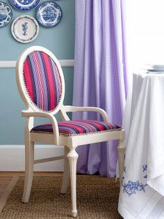 modernize a traditional chair with striped fabric in a bold hue.  I like the thought of black faux snakeskin with gold nailheads!
