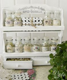 An old spice rack can make a lovely button storage shelf for the craft room.