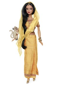 """Dolls of the World (2012) India Barbie is Bollywood-ready adorned in a saffron-yellow sari with a matching hajib-like veil. Golden shoes, monkey friend and """"gold"""" bangles complete the traditional look."""