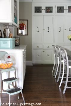 I love this white kitchen and the fun accessories like the blue metal bin for storage eclecticallyvintage.com #HomeGoodsHappy #HappybyDesign #sponsored