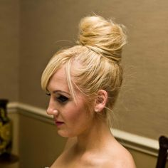 huge bun. make pony on top of head, take sections, tease, pin. ----- this is pretty much what my dance bun looks like without teasing. oh, long hair problems.