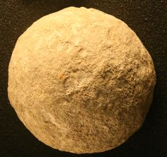 Picture of a stone ball from a set of Paleolithic bolas
