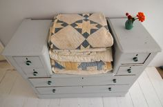 beautiful old quilts and a lovely dresser to boot