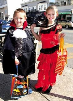 Jen Marra / Gavin and Mali Alexander, 6 and 8 respectively, of Ocean City have fun wearing costumes and visiting Ocean City's downtown shops for sweets.