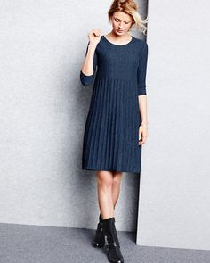 Easily update our Eileen Fisher Washable Wool Scoop-Neck Dress with tights and motor boots when the temperatures start dropping.
