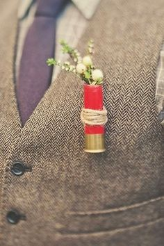 Shotgun Shell Boutonniere Seriously! why didn't I think of this! Why didn't u think of it???? Uh, maybe because it's tacky, cheap, informal, and inappropriate for a wedding, unless maybe you're a family member of the Hatfields or McCoys....
