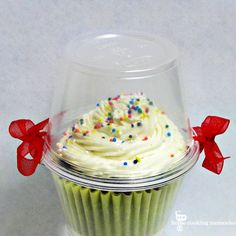 DIY Cupcake Holder: 2 plastic cups, hole punch, and ribbon