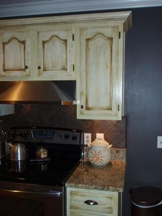 Kitchen cabinets - cream w/chocolate glaze......I think this would look good in greys!