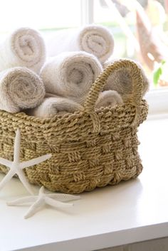 Plush rolled towels with starfish accents