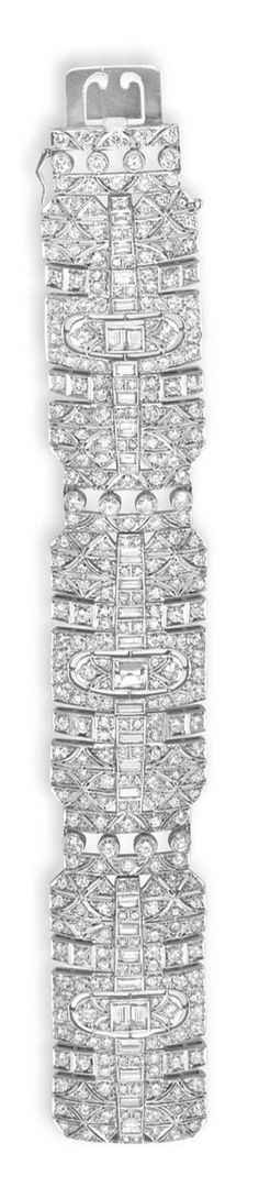 A DIAMOND BRACELET   Designed as an openwork circular and single-cut diamond wide band, set at the center with a graduated series of baguette-cut diamonds, mounted in white gold, 7½ ins.